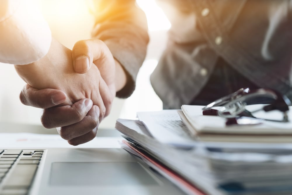 M&A due diligence shaking hands